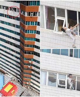 涉事男子将孩子绑在腰间,站在酒店21楼窗边企图跳楼。
