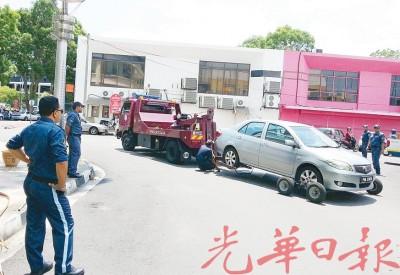 拖欠传票不尚车主将为严厉对付,拖走车子,缴清付款才还车。