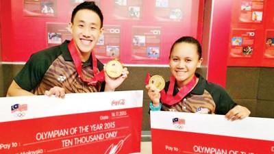 黄兹梁和法汀分别获得大马奥委会最佳男女运动员奖。