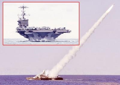 """伊朗海军上周六在""""杜鲁门号""""(小图)附近进行试射。图为伊朗过往的试射演练。"""