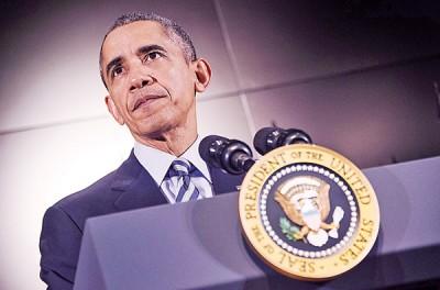 美国总统欧巴马称自己的新年决议是要就枪支暴力课题上再做出努力。(法新社照片)