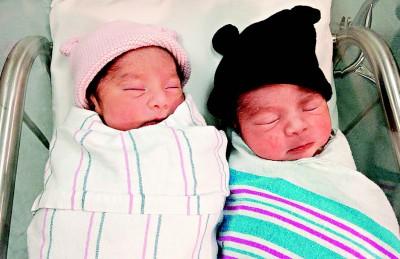 一对双胞胎的出生时间仅差三分钟,出生年份却差一年 !
