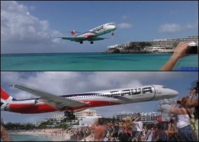 一架客机极低空飞过沙滩。