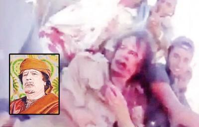 血流披面的卡达菲于同等架货车上。有些图为利比亚前领袖卡达菲曾为时期狂人。(资料图片)