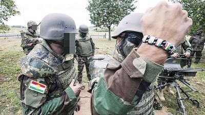 23岁的王源东一有意前往叙利亚,加入一个库尔德民兵组织,对抗伊国组织。图为库尔德民兵组织的士兵。
