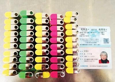 李大妈带了一盒50个的打火机上火车,未能通过安检。