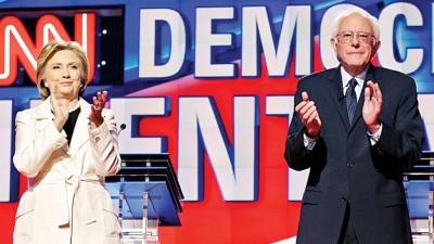 桑德斯(右)在初选选民的支持率上升,但无阻希拉莉(左)领先优势。