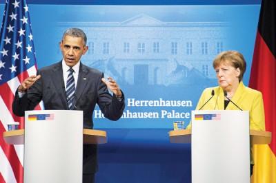 美国总统欧巴马(左)与德国总理默克尔(右)一同会见记者。(法新社照片)