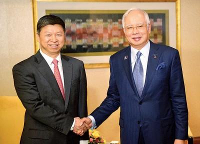 纳吉(右)和中国共中央对外联络部部长宋涛会见。