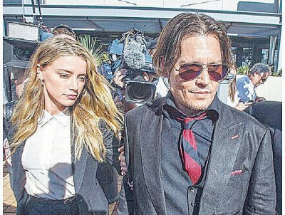 尊尼迪普陪爱妻安柏到澳洲法院出庭。