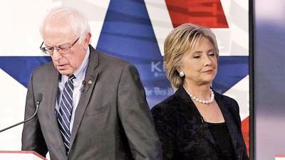 桑德斯(左)承认在肯塔基州初选败给希拉莉(右)。