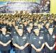 卡立(前排中者)与众警官在国家主权勋章颁发仪式上合影。