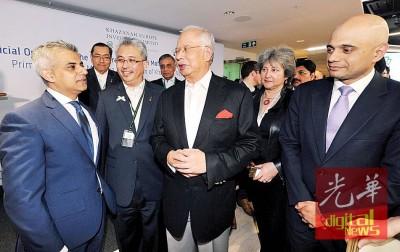 纳吉(左3)和第一伦敦穆斯林市长萨迪克汗(左1)交谈甚欢,左2凡是阿兹曼从没达。