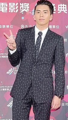国王大陆上星期六与台北电影节,丢掉招牌露齿笑容。