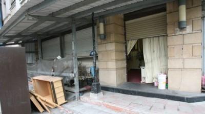 蔡城遗体原本放在三重社区大楼一楼。