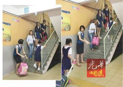 加央群益华小爱心家长列队站在课室楼梯处,以接力方式,帮忙弱小的学生们提书包上楼上课。(由群益华小爱心家长提供)