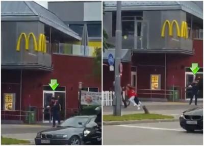民众拍到疑似枪手(箭头示)在商场外连环开枪,民众拔足慌逃。