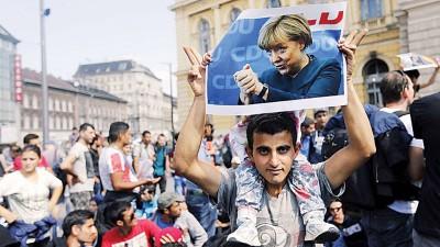 默克尔的移民政策受到质疑。