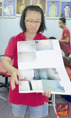 陈金梅展示19楼面对的10年漏水问题。
