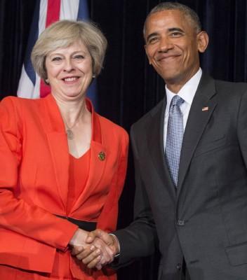 特丽莎梅(左)与欧巴马(右)共同召开的记者会。双方承认两国需尽力减少脱欧对两国关系的影响。(法新社照片)