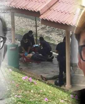 事发当时,救护员为死者陈锦雄(左图)和被告急救,多名警员包围现场。(右图)被告误杀罪名成立,被判坐牢12年。