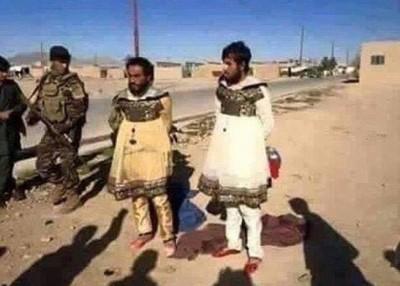 库族部队捉到男扮女装的IS分子。