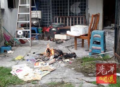 男子周三中午以家庭园烧杂物。