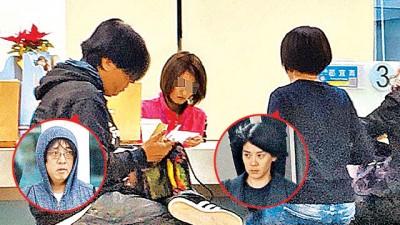 小胖(左)与陆元琪以户政柜枱办理离婚登记。