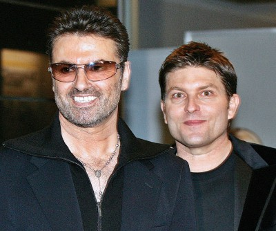 佐治与Kenny Goss(右)爱情长跑13年。