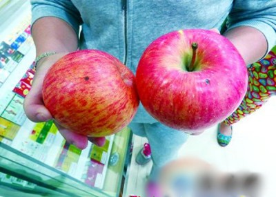 李妇称苹果上有疑似针孔,怀疑被注射了农药。