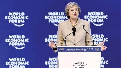 特丽莎梅目前人在达沃斯出席世界经济论坛。(法新社照片)