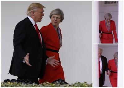 特朗普与英揆特丽莎梅手牵手并肩而行。