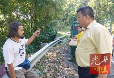 吴俊强在官员陪同下警告试图侵占政府地的工人。