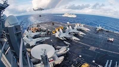 美国军方有意派卡尔文森号航空母舰战斗群的舰船到南中国海巡弋。