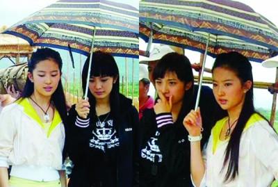 杨幂、刘亦菲(白衣者)在片场互相撑伞,旧照引发热议。