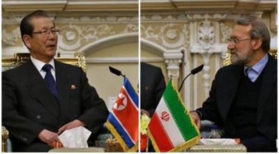 伊朗国会议长拉里贾尼(右)见面到访的朝鲜高人民会议长崔泰福。