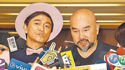辛龙(右)由吴宗宪陪同受访,澄清未中乐透,但网友都不信。