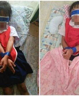 两名女童被蒙眼及绑起双手。