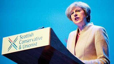 特丽莎梅在苏格兰保守党年会发言。(法新社照片)