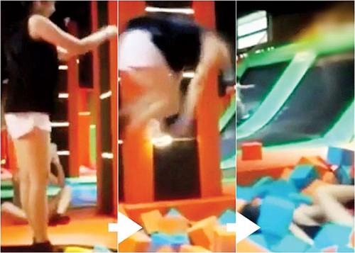阮女士起跳后翻筋斗,然后落入一堆海绵玩具中,却导致自己胸椎骨折。