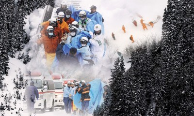 日本救援队将充分伤者抬离现场。