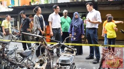 再里尔(右4)、谢嘉平(右1)及槟岛市议员瑟里娜(右5)前来现场了解状况。