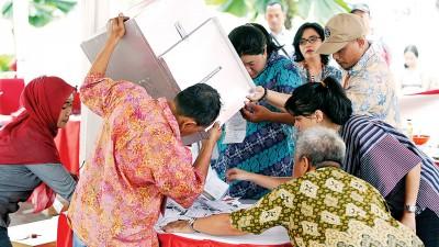 尽管此次选举出现反华情绪,但不少印尼华裔并未因此而吓倒,缺席投票活动。