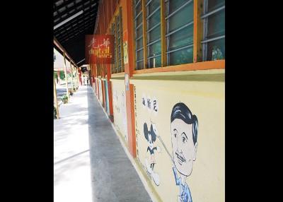 育强校园环境清幽,校舍墙壁更画上著名发明家的画像和作品。