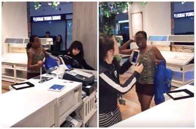 女子在眼镜店里大断叫喊及攻击女店员。