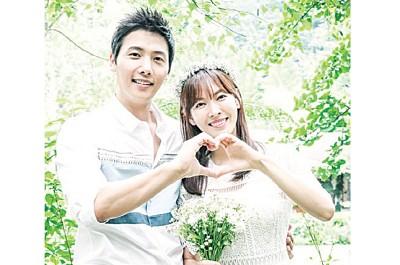 金素妍(右)和李尚禹将完成终身大事。