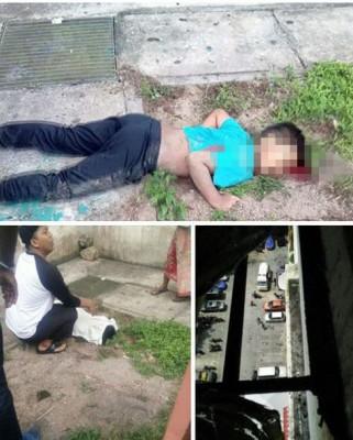 莫哈纳兹鲁不慎从高楼坠下,当场丧命。相信是死者亲友的男子,蹲在一旁。