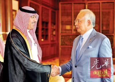 纳吉(右)接见阿瓦沙烈之访问,应出席峰会。