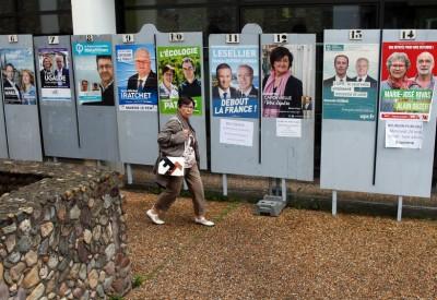 法国街头贴有国会选举的候选人海报。