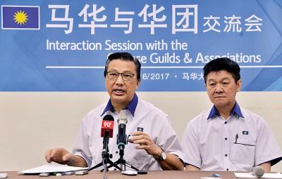 廖中莱:钱游戏已严重毁坏国家形象。右为财政部副部长李志亮。